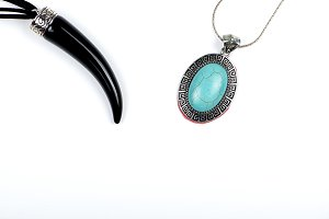 Pendant with black horn shape and pendant with stone on white background. Isolated.
