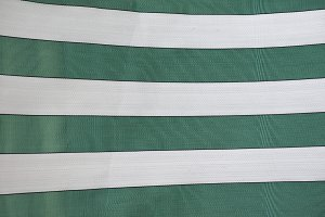 green and white striped fabric texture background