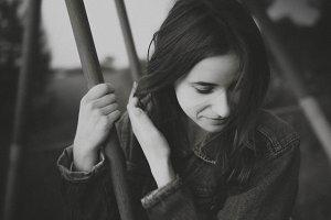 Cute gentle girl on the swing