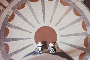 Standing on decorative pattern floor