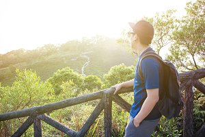 Man hiking and looking out in the mountain - travel and hiking concept