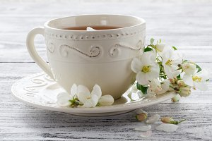 cup of tea with spring flower cherry