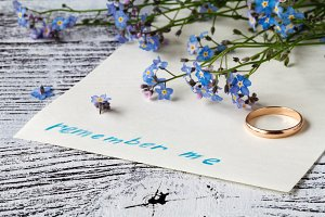 Forget-me-not flower on message note