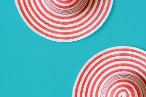 Women's striped summer romantic Hats On a turquoise background.