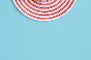 Women's  summer romantic hat On a blue background. Top view with