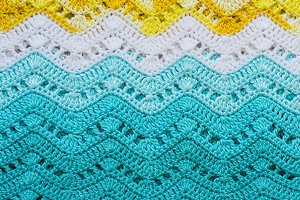 Crocheted multicolored cotton fabric In summer colors. Striped w
