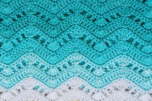 Crocheted multicolored cotton fabric In Turquoise colors. Stripe