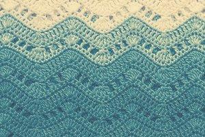 Crocheted multicolored cotton fabric In blue colors. Striped wav