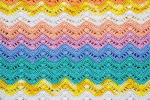 Crocheted multicolored cotton fabric In summer colors. Striped w