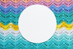 Crocheted multicolored cotton fabric In summer colors. Round whi