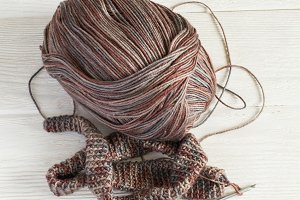 Knitted fabric in Gray winter tones, Ball of threads and crochet