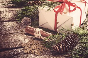 Christmas box and conifer branches