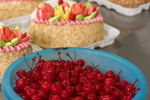 Bowl of cherry on cake production