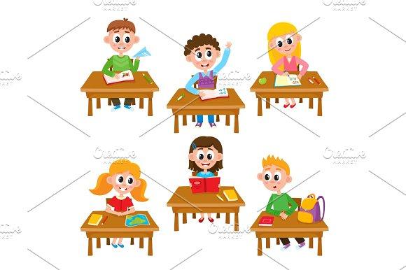 Elementary School Kids In Classroom Reading Writing Raising Hand Studying