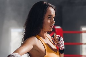 Young fitness beautiful brunette girl on the ring