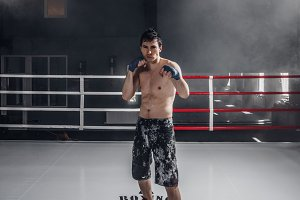 Young man boxing workout on the ring