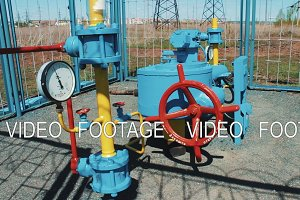 Station for pumping natural gas. Processing and storage of gas and oil. pumping station. Pipeline with a requested valve and a manometer. Oil and gas industry. Extraction of natural resources. Fuel fabrication.