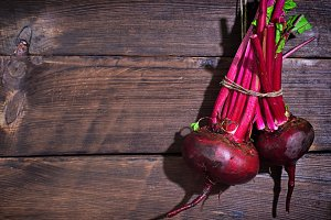 Two fresh red beets hang
