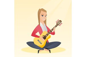Woman playing the acoustic guitar.