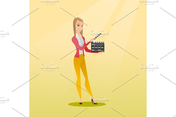 Smiling Woman Holding An Open Clapperboard