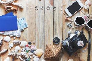 Striped espadrilles, money, passports and marine decorations