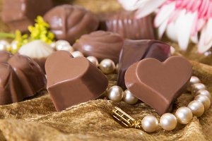 assortment of chocolates with collar and flowers