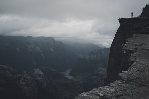 Standing on Preikestolen Rock Norway