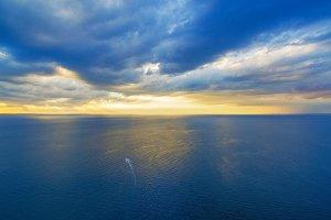 Aerial view of ocean at sunset