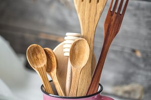 wooden kitchen utensils in Cup