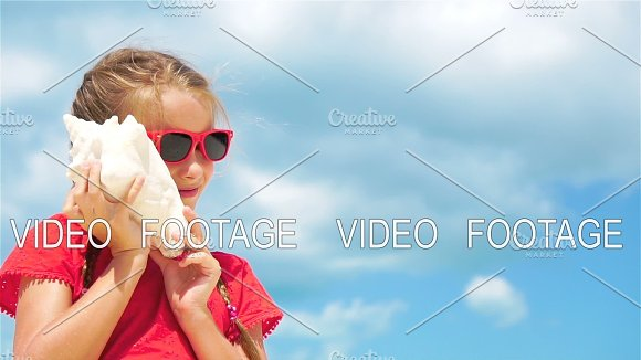 Adorable Kid Listening A Big Seashell On White Tropical Beach SLOW MOTION