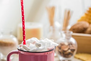 a delicious Cup of cocoa with marshmallows and straws