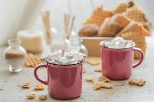 two cups of cocoa with marshmallows