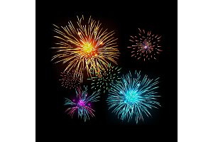 Colorful fireworks isolated on the dark background.