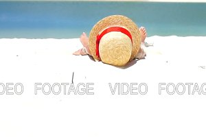 Cute little girl in hat at the beach during caribbean tropical vacation. SLOW MOTION.