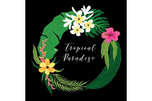 Beautiful tropical flowers and palm leaves wreath as frame