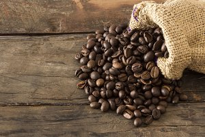 Coffee Beans isolated on wood bg