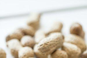 Unshelled peanuts close up