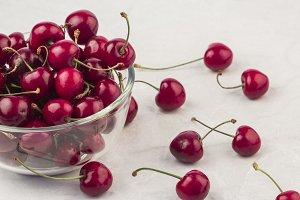 fresh picked cherries on white