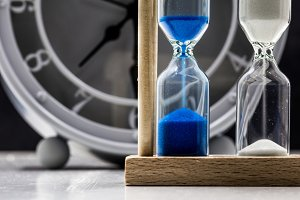 table clock with sand closeup