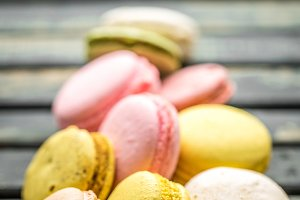 Colorful macaroons on wooden background