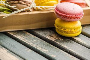 macaroon in a box on wooden background