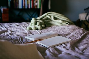 moody journal, notebook on bed