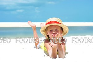 Portrait of little girl in hat at the beach during caribbean tropical vacation. SLOW MOTION.