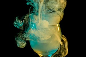 Yellow-green smoke in glass