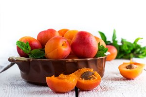 Ceramic bowl with organic ripe apricots