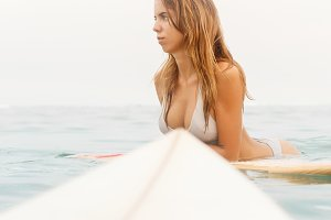 Beautiful hot girl with surf board.