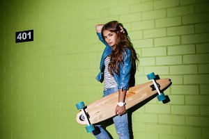 Beautiful hot girl with skateboard.