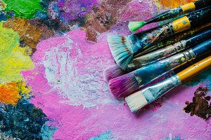 Paintbrushes on abstract background
