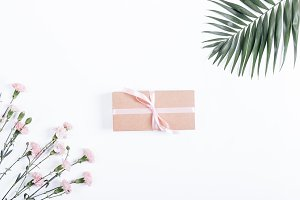 Box with ribbon and gift