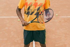 Full leg portrait of tennis player man